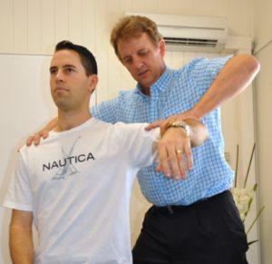 Chiropractor-examination-of-shoulder